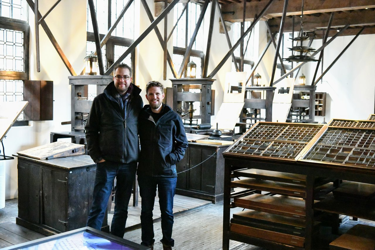 Dries and Matt in front of the oldest printing presses in the world