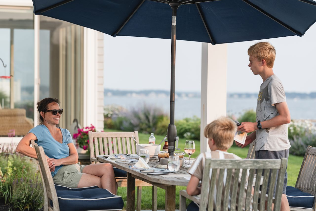 Eating dinner outside overlooking the ocean