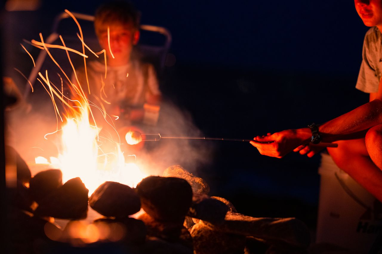 A aarshmallow over a camp fire